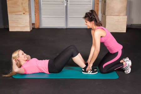 crunches: Woman doing crunches fiitess exercise on a yoga mat