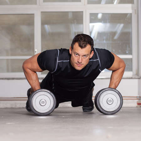 crossfit: man push up on barbell crossfit