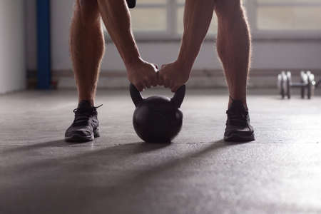 crossfit - kettlebell training backlit Stock Photo