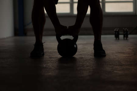 home gym: crossfit - kettlebell training backlit Stock Photo