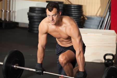 crossfit: crossfit training man with barbell