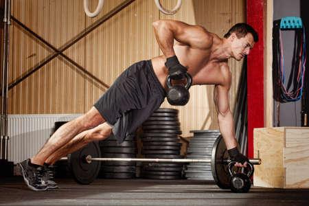 push up on kettlebells Stock Photo