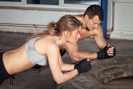 crossfit: man and woman on a tire crossfit fitness training Stock Photo