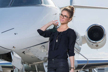 business woman leaving a airplane Stock Photo