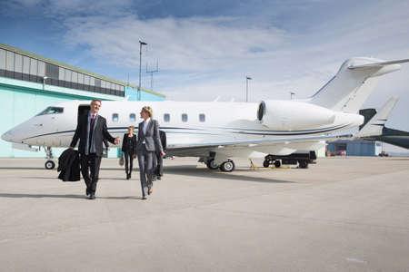 executive business team leaving corporate jet photo