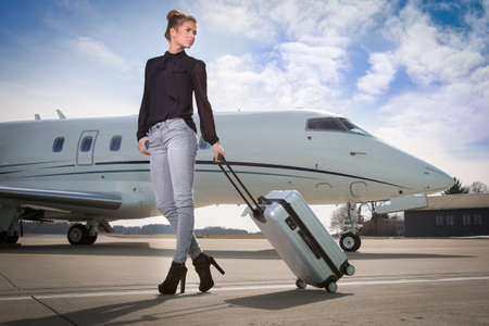 executive business woman leaving a corporate jet
