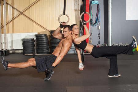 pistols: Pistols cross exercise fit fitness training Stock Photo