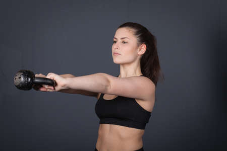 amortization: Woman doing a kettlebell fitness exercise