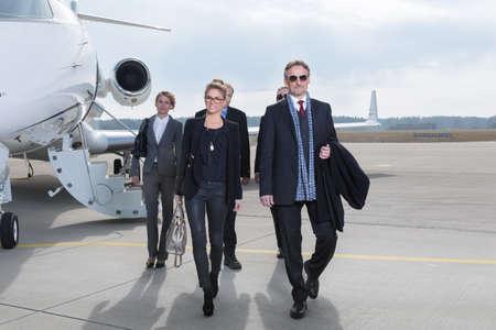executive business team leaving corporate jet