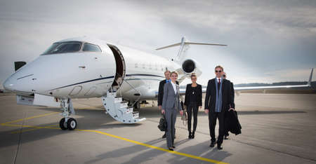 corporate jet: executive business team leaving corporate jet
