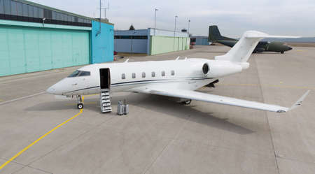corporate private jet with luggage in front Standard-Bild