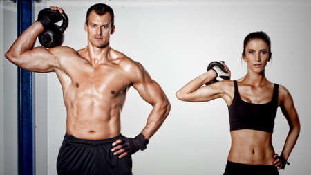fit man: crossfit kettlebell fitness training man and woman Stock Photo