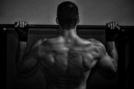 pushup: crossfit pull up fitness exercise - back of a man Stock Photo
