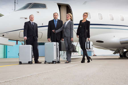 corporate jet: executive manager leaving corporate jet handshake with pilot