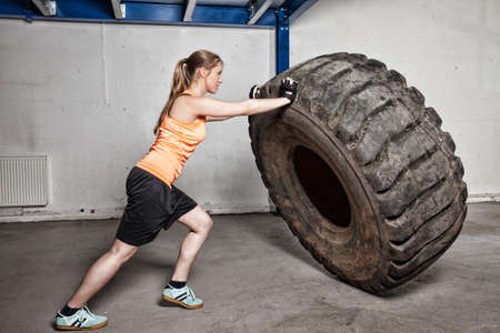 woman flipping tire Stock Photo