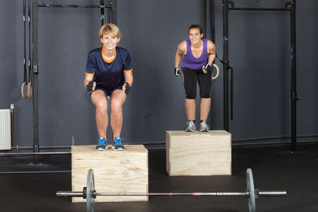 Woman fitness training - jump on a box