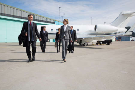 private airplane: executive business team leaving corporate jet