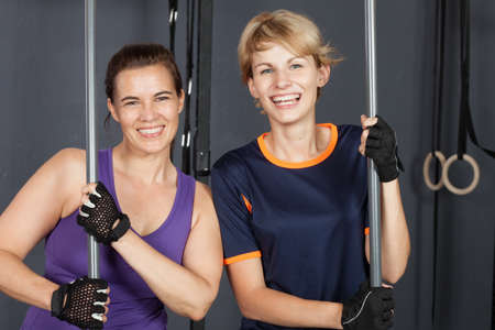 gym dress: sports woman crossfit barbell training with plastic bar