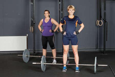 gym dress: sports woman barbell training Stock Photo