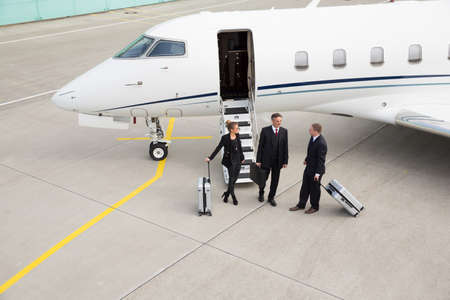 corporate jet: executive manager in front of corporate jet