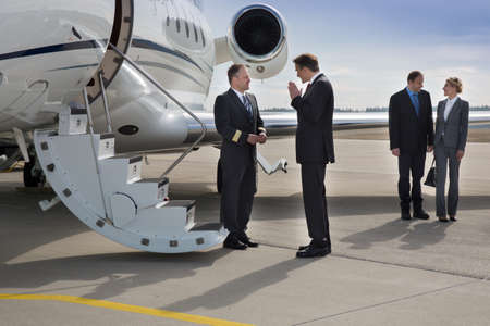 jet plane: executive manager instructung pilot of corporate jet