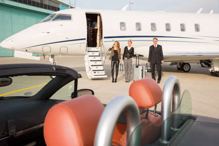 corporate jet: executive business team leaving corporate jet