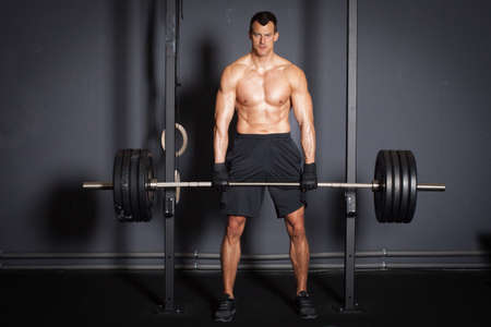 Weight lifting fitness training man