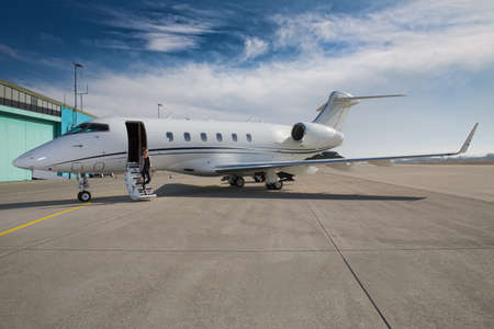 corporate jet: executive business woman leaving a corporate jet plane