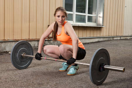 outoors: Weight lifting fitness training woman Stock Photo