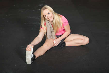 warm up: warm up - woman steching legs - fitness Stock Photo