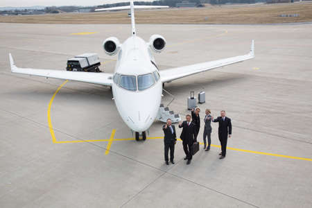 corporate jet: thumbs up - executive business team corporate jet