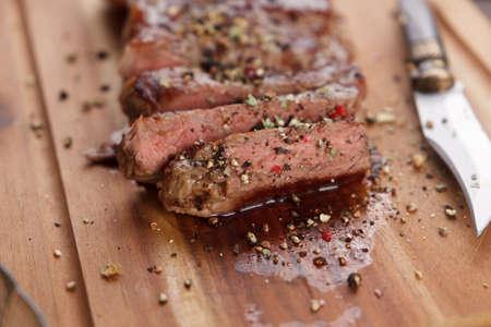 Fillet steak - rump steak on a wooden plate