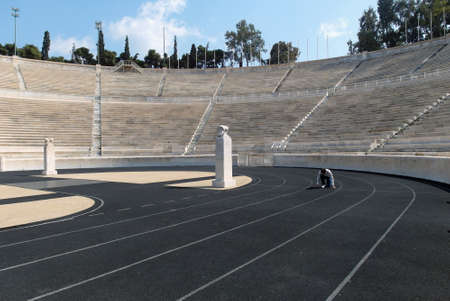 olympic stadium: Man Running in Old Olympic Stadium