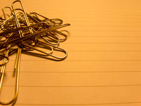 writing on paper: Paper Clips on writing paper stock image