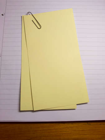 writing on paper: Blank paper writing paper with one paper clip stock image