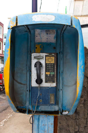 make public: Old Pay phone by the street