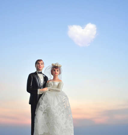 miniature wedding doll with heart shaped cloud