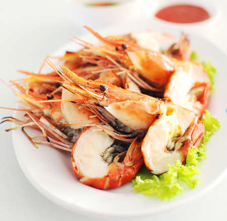 shrimp seafood in white plate photo