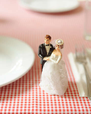 miniature wedding model doll on dinning table  photo