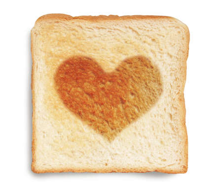 toasted bread with heart shape burnt photo