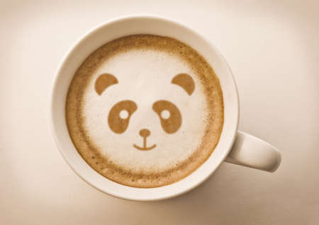 latte art: panda face on latte art drawing coffee cup