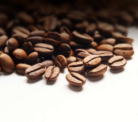 coffee harvest: coffee beans on white background