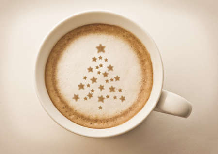 christmas drink: christmas tree , drawing on latte art coffee cup