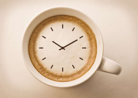 coffee time , watch drawing on latte art coffee cup Stock Photo