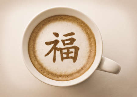 blessing: chinese new year blessing letter on latte art coffee cup