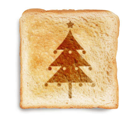 christmas tree picture burn mark on toast  bread, isolated on white background photo