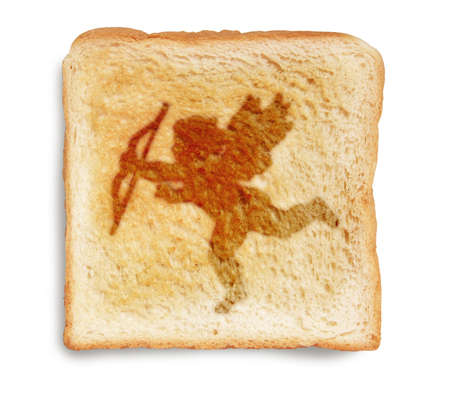 valentines cupid picture burn mark on toast  bread, isolated on white background photo