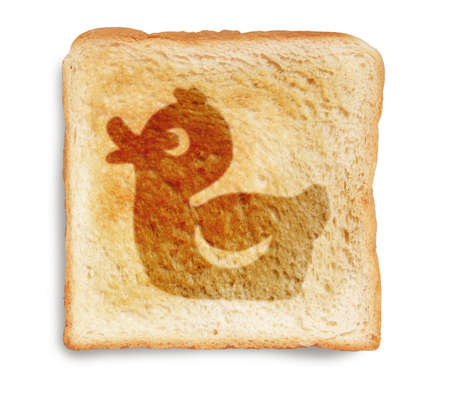 toast bread with rubber duck picture burn mark isolated on white background photo