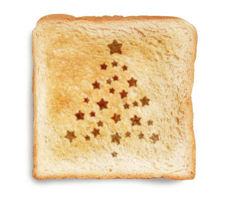 christmas tree burn mark on toast bread, isolated on white background  photo