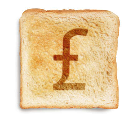 money to burn: english pound sterling burn mark on toast bread, isolated on white background